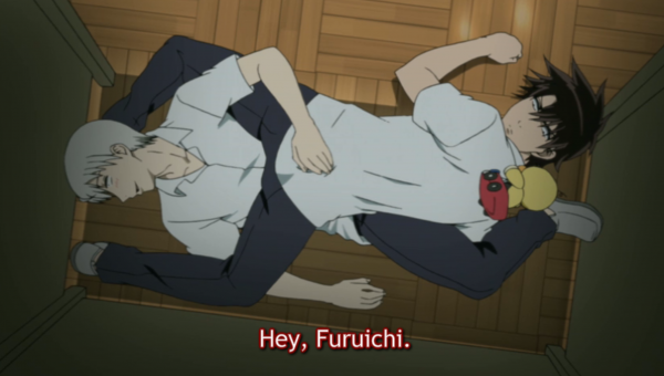 Oga and Furuichi trapped under a desk.